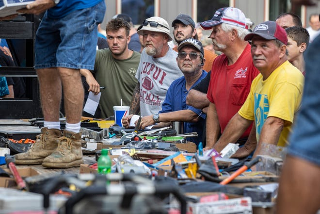 """Potential bidders browse tools and other items during an auction held at Tim Stark's """"Wildlife in Need"""" ranch in Charlestown, Ind."""