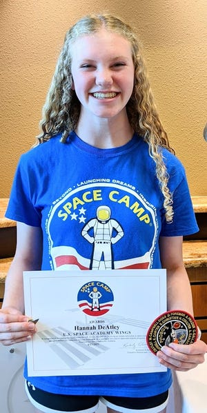 Hannah DeAtley poses with her Space Camp wings and patch. DeAtley became inspired to become an aerospace engineer after watching a movie about NASA mathematician Katherine Johnson.
