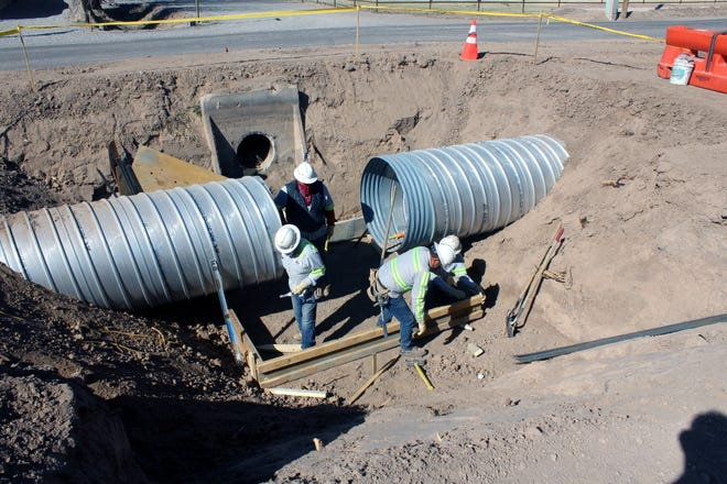 An Elephant Butte Irrigation District crew works on footing for a distribution box on the Picacho Pipeline.