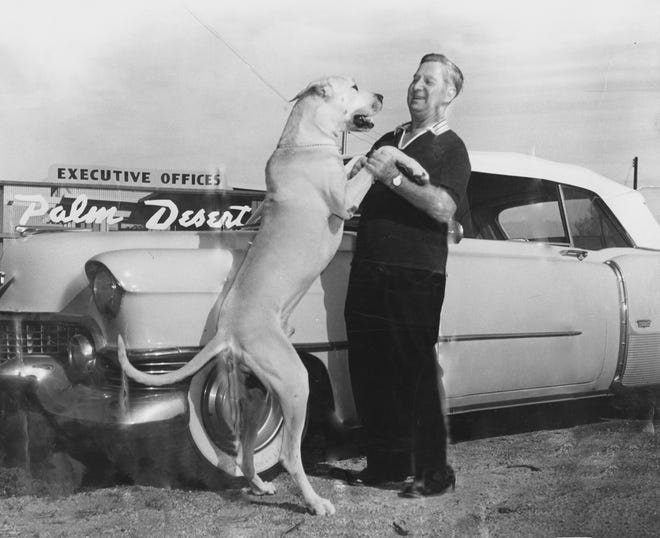 """Cliff Henderson and his beloved Great Dane """"Dakar"""" in front of the Palm Desert Corporation sales office circa 1951."""