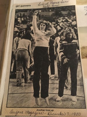 Lisa Olson participating in a half-court shot contest during a Suns game, as pictured in the Dec. 7, 1980 Arizona Magazine.