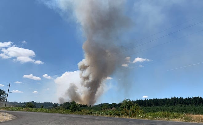 Smoke rises above an agricultural test burn near Scio on Friday, July, 16, 2021.