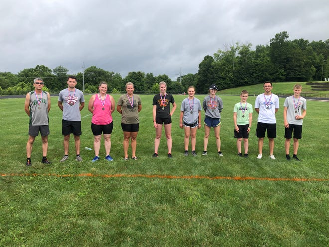 The New Lex Cross Country teams held its 5K fundraiser on Saturday. Pictured are the medalist for the various age groups.