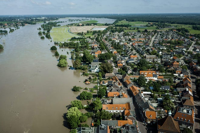 This aerial photograph taken above the Maas river shows the extend of the flood waters near the evacuated town of Arcen on 17 July 2021. - Troops and firefighters scrambled through the night July 17 to find victims of the devastation left by the worst floods to hit western Europe in decades, which have already left more than 150 people dead and dozens more missing. (Photo by Remko de Waal / ANP / AFP) / Netherlands OUT (Photo by REMKO DE WAAL/ANP/AFP via Getty Images)