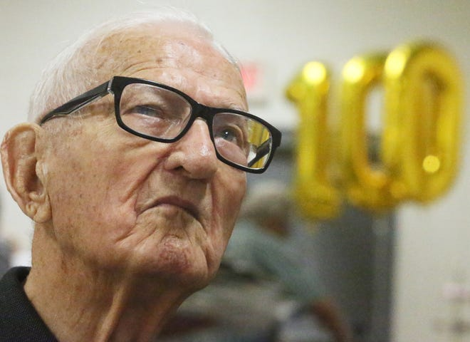 Harold Horvath pauses to reflect on his life at his 100th birthday celebration Sunday at the United Steelworkers hall in Akron. Horvath was born on July 18, 1921.
