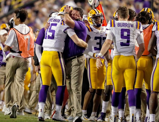 LSU head coach Ed Orgeron hugs backup quarterback Myles Brennan during the 2019 game against Texas A&M in Baton Rouge, La. Brennan figures to have the inside track at this year's starting job, but Max Johnson is challenging him.
