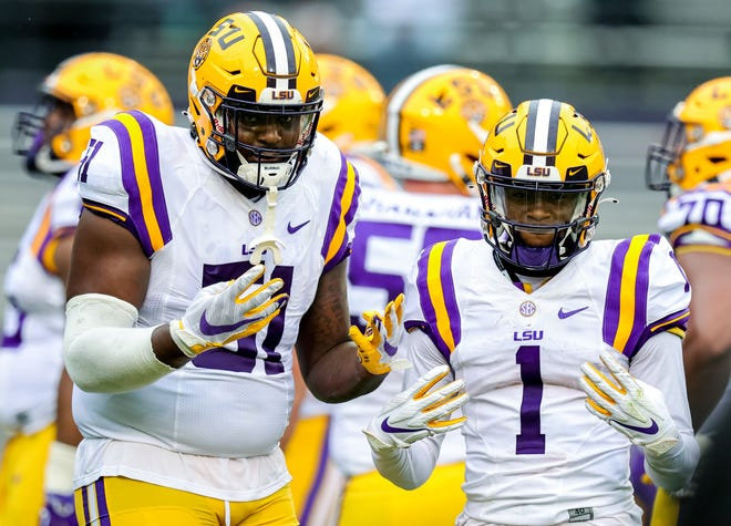 LSU offensive tackle Dare Rosenthal, left, and wide receiver Kayshon Boutte pose for the camera during LSU's spring game in April. Boutte is expected to take over the alpha receiver's role in this year's Tigers' offense.