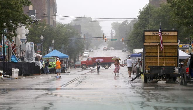 Heavy rain dampened a new community event Saturday, as the Historic Main Street Festival attracted a sparse crowd early on. The rain cleared out before evening, and some of the event's entertainment and events were held on various stages along East Main Street.