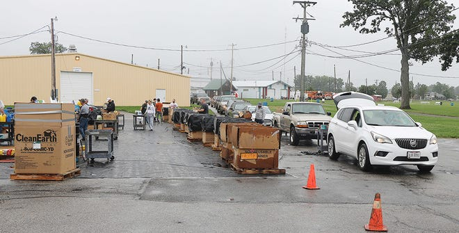 Traffic lines up at the Ashland County Fairgrounds on Saturday morning to dump household hazardous waste. Workers collected the items from residents' cars. TONY ORENDER, TIMES-GAZETTE.COM