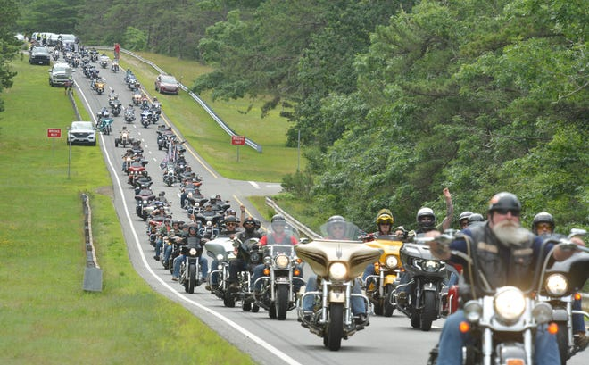 BOURNE -- 07/18/21 -- Bikers head out of the Barnstable County Sheriff's Complex and onto Connery Avenue at the start of Big Nick's Ride for the Fallen.  Hundreds of motorcycle riders participated in the 12th annual Big Nick's Ride for the Fallen. The ride is memory of U.S. Marine Corps Corporal Nicholas Xiarhos and in honor of those fallen military personnel that have ties to the Cape. Xiarhos who was killed in action in July 2009 in Afghanistan, is one of the 16 fallen warriors from the Cape.