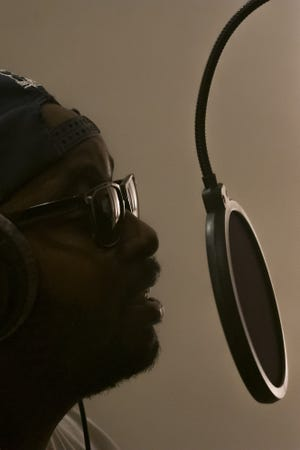 """Hip-hop artist Jonah """"Big Jld"""" Huggins records a vocal track during a recording session with engineer Jimmy DeRosa at Oranjudio Recording in Columbus."""