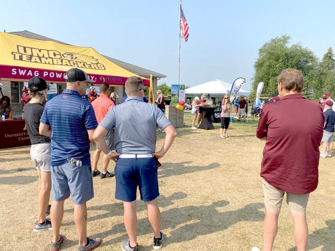 UMN Crookston Chancellor Mary Holz-Clause greets everyone and makes some remarks prior to tee-off Friday at the Teambacker Golf Classic at Minakwa Golf Course.