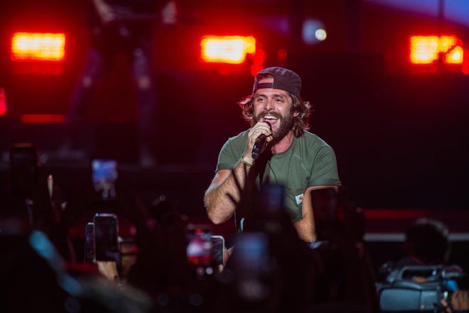 Thomas Rhett sings to the fans Saturday during the Faster Horses country music festival at Michigan International Speedway in Cambridge Township.