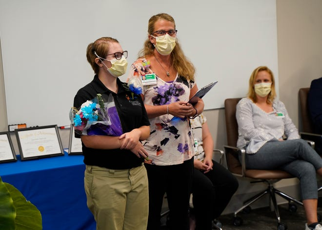 Student Larisa Dowhaniuk, left, receives recognition from Andrea Rupp, ProMedica speech-language pathologist site leader, during the Project SEARCH celebration of achievement at ProMedica Charles and Virginia Hickman Hospital.