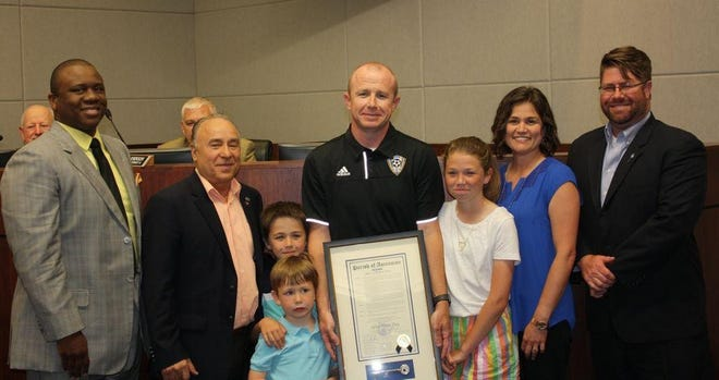 New Dutchtown girl's soccer coach Jared Moss being honored in 2018. Parish President Kenny Matassa proclaimed April 19, 2018, Jared Moss Day.