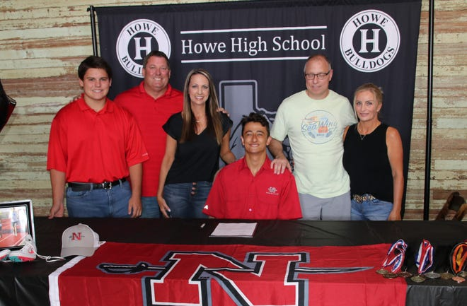 Howe's Jake Fabacher signs his letter of intent to run cross-country and track for Nicholls State University.