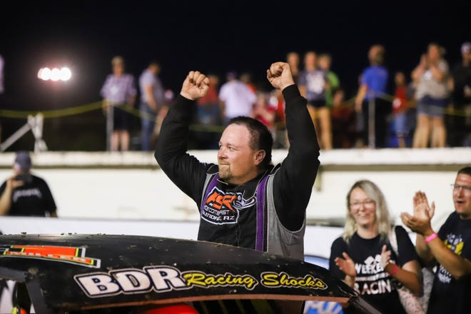 Hutchinson's Scott Miller celebrates after winning and defending the stock car division at the 65th Hutchinson Grand Nationals auto races at the Kansas State Fairgrounds Saturday, July 17, 2021.