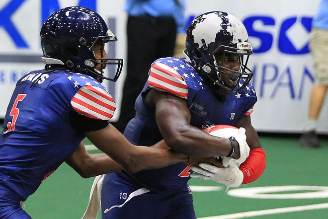 Salina Liberty's Tracy Brooks (2) takes the handoff from quarterback Tyrie Adams (5) during their Champions Bowl VI game against the Omaha Beef Saturday night at the Tony's Pizza Events Center. Brooks was named the Champions Indoor Football League's Most Valuable Player on Monday night.