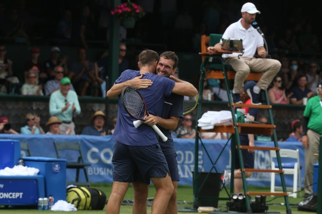 Jack Sock gets winning hug from William Blumberg, right.
