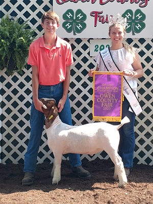 Kolton Jackson was the Grand Champion of the 2021 Owen County Fair Meat Goat Show market goat. He is shown above with his winning entry, alongside 2021 OC Fair Queen Elizabeth Beeman.