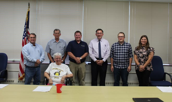 The Spencer-Owen School Board posed for a photo with new superintendent Andy Cline. Shown, front row, is school board member Sonia Brinson. Back row: school board members Jack White, Rick Smeltzer, Chad Cooper, Superintendent Andy Cline, and school board members Derek Morgan and Amber Willen.