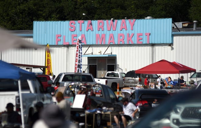 People walk around Starway Flea Market in Wilmington, N.C., Sunday, July 18, 2021. The Wilmington Planning Commission approved a rezoning along Carolina Beach Road to allow for the construction of affordable apartments on a site that currently is home to the market.