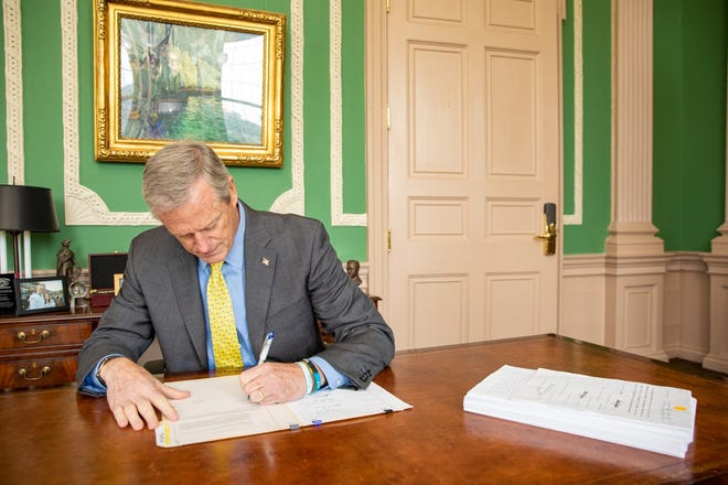 Gov. Charlie Baker signs the state budget into law July 16.