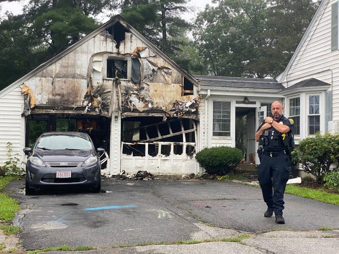 West Brookfield Police Officer Frank Jolin outside the West Main Street home where he led three people to safety during an early-morning fire Sunday.