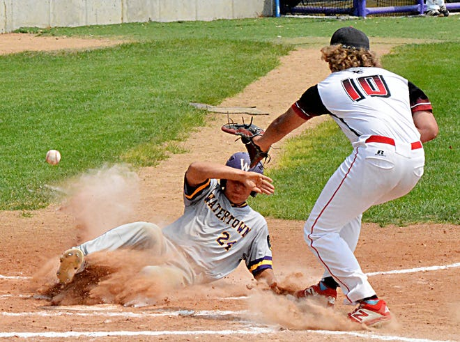 Watertown Post 17 base runner Zach Hirsch scores on a passed ball while Rapid City Post 320 pitcher Xander Dansby awaits the throw during Game 2 of their best-of-three, state-qualifying American Legion Baseball playoff series Saturday afternoon at Watertown Stadium.