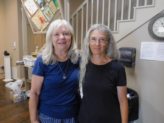 Instructor Barbara Woods, left, and her art assistant Carol Cull.