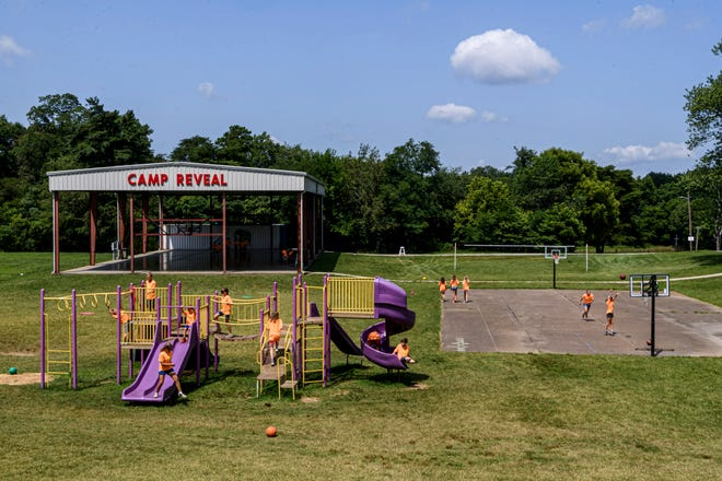 Children play and relax together during free time at Camp Reveal in Evansville, Ind., Thursday afternoon, July 15, 2021.