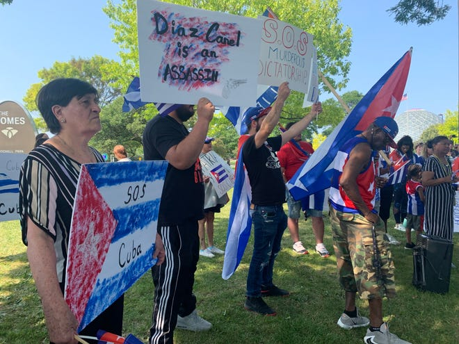 Several dozen people gathered at Mitchell Park on Sunday, July 18, to stand in solidarity with people who are protesting in Cuba against the communist government, something that has not been seen in decades.