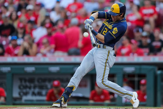 Brewers leftfielder Christian Yelich bats against the Cincinnati Reds in the first inning Saturday.
