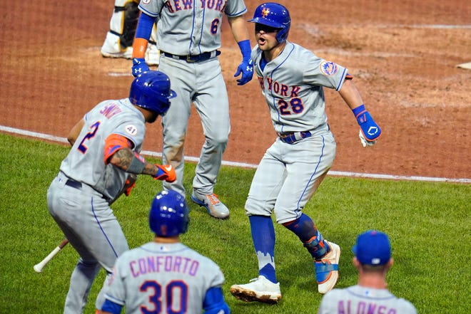 New York Mets' J.D. Davis (28) celebrates with Dominic Smith (2) as he returns to the dugout after hitting a two-run home run off Pittsburgh Pirates starting pitcher Wil Crowe during the fourth inning of a baseball game in Pittsburgh, Saturday, July 17, 2021. (AP Photo/Gene J. Puskar)