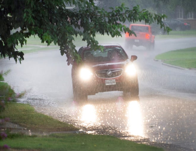 The area saw some heavy rain showers with lightning that caused grassfires and power outages Saturday afternoon.