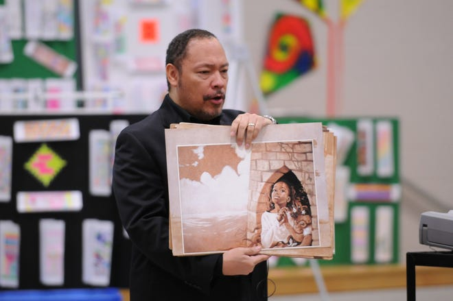 In this file photo, Floyd Cooper presents an upcoming book to elementary school students.