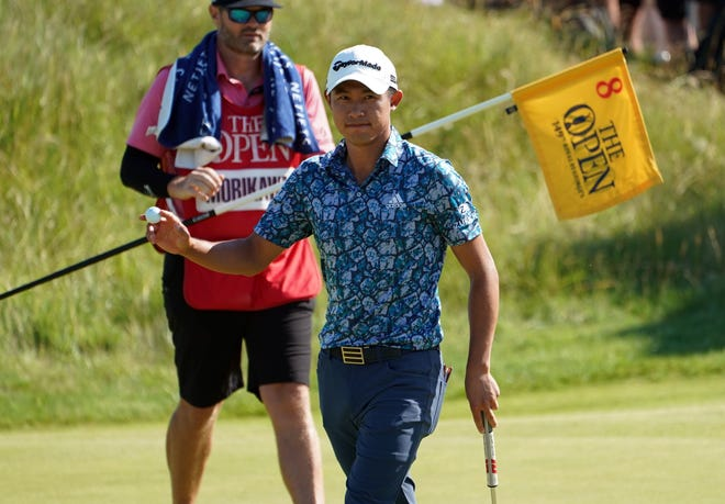 Collin Morikawa waves to the gallery on the eighth green during the final round of the Open Championship.
