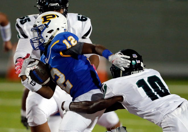 Connally's Roman Mason, right, wraps up Pflugerville's Jake Iloka in a nondistrict game at The Pfield last season. Mason leads a talented secondary that looks like a team strength for the Cougars.