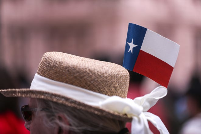 """A small Texas flag sits on the hat of Carolyn Boyle. About 200 activists attended a """"Let My People Vote,"""" rally on July 19 at the Texas Capitol to urge state lawmakers to rethink restrictive new voting laws. [AMERICAN-STATESMAN/FILE]"""