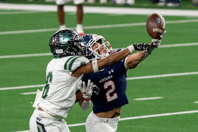 Cedar Park defensive back Michael Putney, left, breaks up a pass intended for Denton Ryan wide receiver Billy Bowman Jr. during the first half of the Class 5A Division I state championship game in January. Putney is back as arguably the top cover corner in the Austin area.