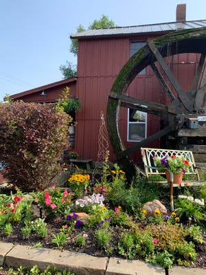 The Wine Mill, housed in a historic 1846 building, features a lovely garden patio and a working water mill.