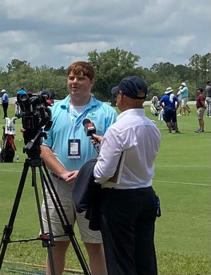 The Hampton County Guardian correspondent Alex Jones was interviewed by local TV news reporters at the Congaree Golf Club.