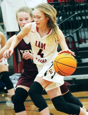 Jade Upton, right, has been a contributor since her freshman season for the Caney Valley High School girls basketball team.