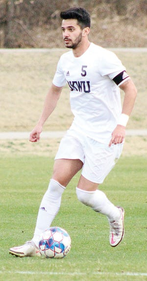 Julio Belo works the ball downfield for the men's soccer team of Oklahoma Wesleyan University.