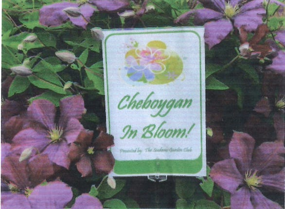 These signs will start popping up around Cheboygan next week as the Seedums Garden Club starts looking for gardens blooming throughout the city.