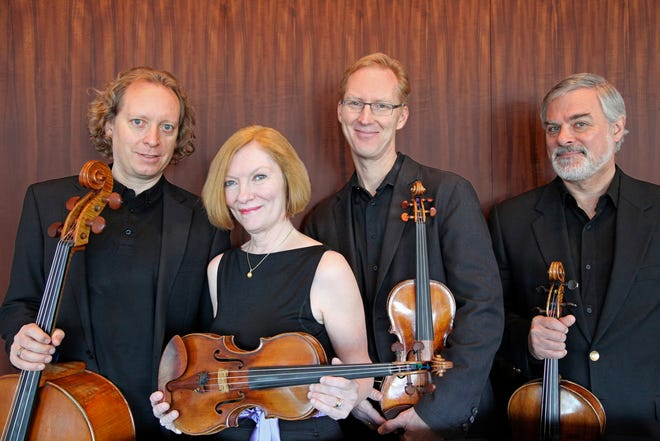 American String Quartet from left to right, cellist Wolfram Koessel, violinist Laurie Carney and her Tononi, first violinist Peter Winogard, violist Daniel Avshalomov.