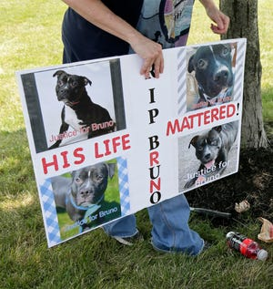 Animal rights activists and concerned pet owners gathered July 18 outside the Franklin County Dog Shelter at the corner of Morse Road and Tamarack Boulevard to protest the shelter's adoption policies following the death in late June of Bruno, a pit bull who had been adopted in March after being the shelter's longest tenant at 180 days.