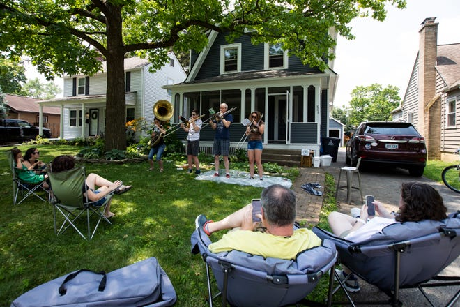 The WesterHornz, an all-brass family band consisting of, from left, Deb, Jack, Gracie and Rob Westergaard, perform on their front lawn earlier this month to entertain neighbors and raise money for St. Baldrick's Foundation.