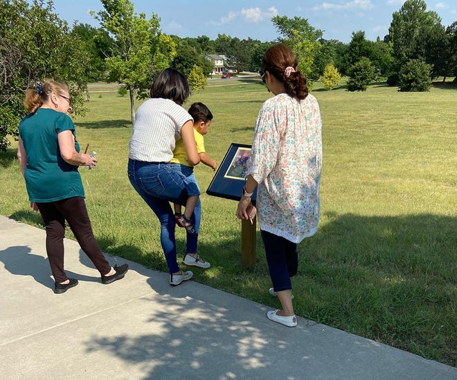 The Obando family of Dodge City visited the StoryWalk of Dreamers by Yuyi Morales in Spiers Park, near Northern Avenue and Manor Drive. The StoryWalk allows everyone to read the book as you move further down the path.