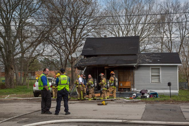 The Mt. Pleasant Fire Department, Columbia Fire and Rescue,  Maury Regional EMS and Mt. Pleasant Police Department respond to a house fire on Third Avenue in Mt. Pleasant on Thursday, March 14, 2019.
